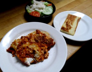 Our Homemade Lasagna comes with side salad and garlic bread
